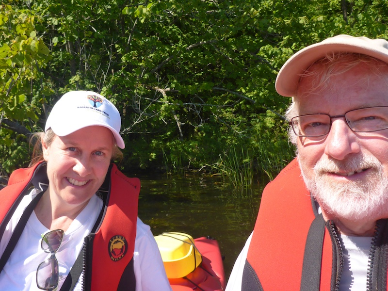 A woman, Janet Kelly and man, Warren Dunlop, pose for a selfie in their canoe.